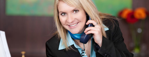 Hotel Receptionist On Phone